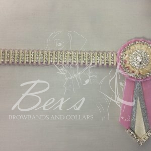 "3/4"" Crystal Show Browband: Baby Pink velvet background, 4 rows of Silver crystal chain woven on with Cream satin. Pleated rosettes with plain Silver double row crystal rings and centres. V shaped tails with Silver crystal flag tips"