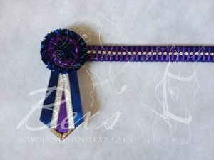 "3/4"" Crystal Show Browband: Light Navy satin background, 1 row of Silver crystal chain woven on with Regal Purple satin. Pleated rosettes with fabric rose centre. V shaped tails with Silver patterned flag tips"