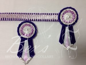 "1"" Crystal Show Browband: Purple velvet background, 4 rows of Silver crystal chain woven on with Light Orchid satin. Pleated rosettes with plain Silver double row crystal rings and centres. V shaped tails with Silver crystal flag tips. Shown here with removable rosettes."