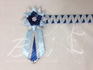 """3/4"""" Ribbon Show Browband: Light Blue, Light Navy and Silver satin narrow diamond. Star shaped rosettes with fabric flower centre. V Shaped tails with Silver patterned flag tips."""