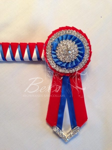 """3/4"""" Ribbon Show Browband: Red velvet, Royal and White satin narrow double shark tooth. Pleated rosettes with plain Silver double row crystal rings and plain centre. V shaped rosette tails with Silver crystal flag tips."""