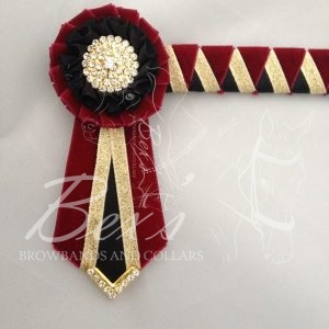 """3/4"""" Ribbon Show Browband: Wine velvet, Gold metallic lame and Black satin wide double shark tooth. Pleated rosettes with plain Gold crystal centre. V Shaped tails with Gold crystal flag tips."""