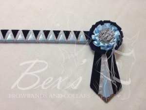"""3/4"""" Ribbon Show Browband: Navy velvet and Light Blue satin wide shark tooth with Silver metallic lame zig zag. Pleated rosettes with fabric rose centres. V Shaped tails with Silver patterned flag tips."""