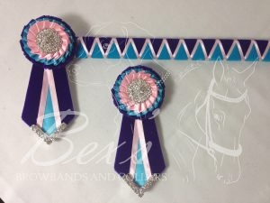 """3/4"""" Ribbon Show Browband: Purple and Orient velvet wide shark tooth with Light Pink satin zig zag. Pleated rosettes with plain Silver crystal centres. V Shaped tails with Silver crystal flag tips. Shown here with removable rosettes."""
