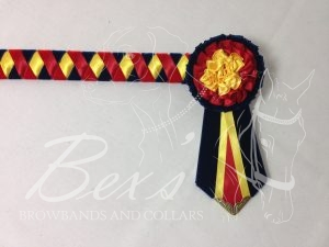 """Custom 3/4"""" Ribbon Show Browband: Red and Navy velvet and Red and Daffodil satin wide diamond. Pleated rosettes with fabric rose centres. V Shaped tails with Gold patterned flag tips."""