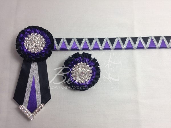 """3/4"""" Ribbon Show Browband: Regal Purple and Black satin wide shark tooth with Silver metallic lame zig zag. Pleated rosettes with plain Silver crystal centres. V Shaped tails with Silver crystal flag tips. Shown here with a matching buttonhole."""
