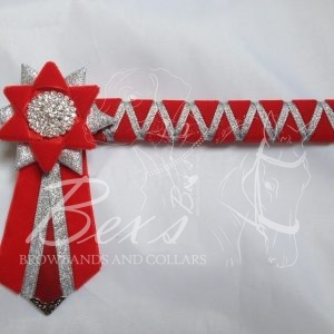 """3/4"""" Ribbon Show Browband: Red velvet wide shark tooth with Silver metallic lame zig zag. Star shaped rosettes with plain Silver crystal centres. V Shaped tails with Silver patterned flag tips."""