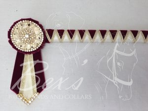 """3/4"""" Ribbon Show Browband: Wine velvet and Cream satin wide shark tooth with Gold metallic lame zig zag. Pleated rosettes with plain Gold double row crystal rings and plain centres. V Shaped tails with Gold crystal flag tips."""