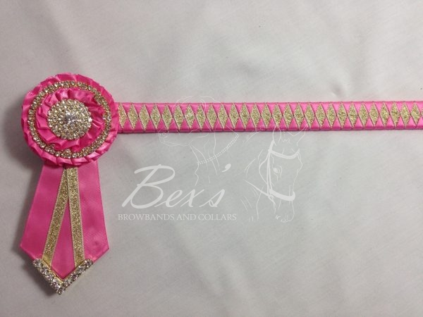 """3/4"""" Ribbon Show Browband: Hot Pink satin and Gold metallic lame narrow diamond. Pleated rosettes with plain Gold double row rings and plain centres. V Shaped tails with Gold crystal flag tips."""