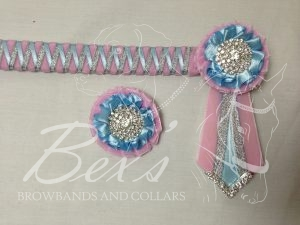 "3/4"" Ribbon Show Browband: Baby Pink velvet narrow shark tooth with Light Blue satin and Silver metallic lame zig zag. Pleated rosettes with plain Silver crystal centre. V Shaped tails with Silver crystal flag tips. Shown here with a matching buttonhole."