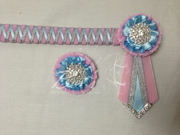 """3/4"""" Ribbon Show Browband: Baby Pink velvet narrow shark tooth with Light Blue satin and Silver metallic lame zig zag. Pleated rosettes with plain Silver crystal centre. V Shaped tails with Silver crystal flag tips. Shown here with a matching buttonhole."""