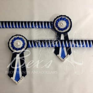 """3/4"""" Ribbon Show Browband: Navy velvet and Royal and White satin narrow double shark tooth. Pleated rosettes with plain Silver double row crystal rings and plain centre. V Shaped tails with Silver crystal flag tips"""