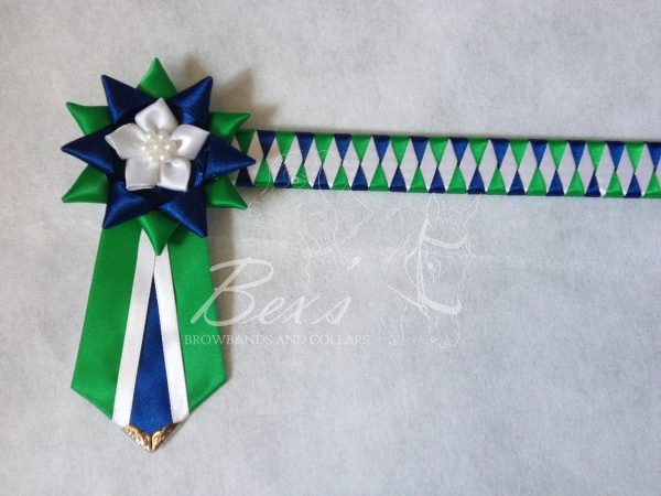 """3/4"""" Ribbon Show Browband: Emerald, Light Navy and White satin narrow diamond. Star shaped rosettes with fabric flower centre. V Shaped tails with Silver patterned flag tips."""