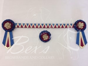"3/4"" Ribbon Show Browband: Light Navy and Wine satin wide shark tooth and Gold metallic lame zig zag. Pleated rosettes with fabric rose centre. V Shaped tails with Gold patterned flag tips. Shown here with a matching buttonhole."