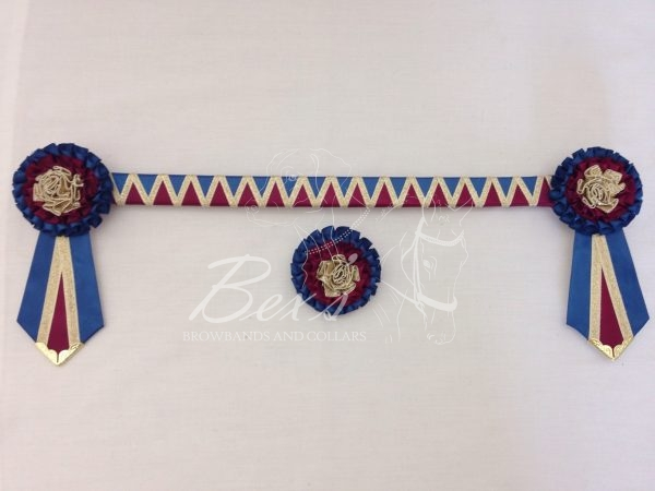 """3/4"""" Ribbon Show Browband: Light Navy and Wine satin wide shark tooth and Gold metallic lame zig zag. Pleated rosettes with fabric rose centre. V Shaped tails with Gold patterned flag tips. Shown here with a matching buttonhole."""