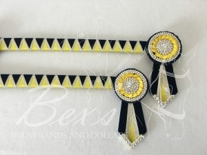 "3/4"" Ribbon Show Browband: Black velvet and Daffodil satin wide shark tooth and Gold metallic lame zig zag. Pleated rosettes with plain Gold double row crystal ring and plain centre. V Shaped tails with Gold crystal flag tips"