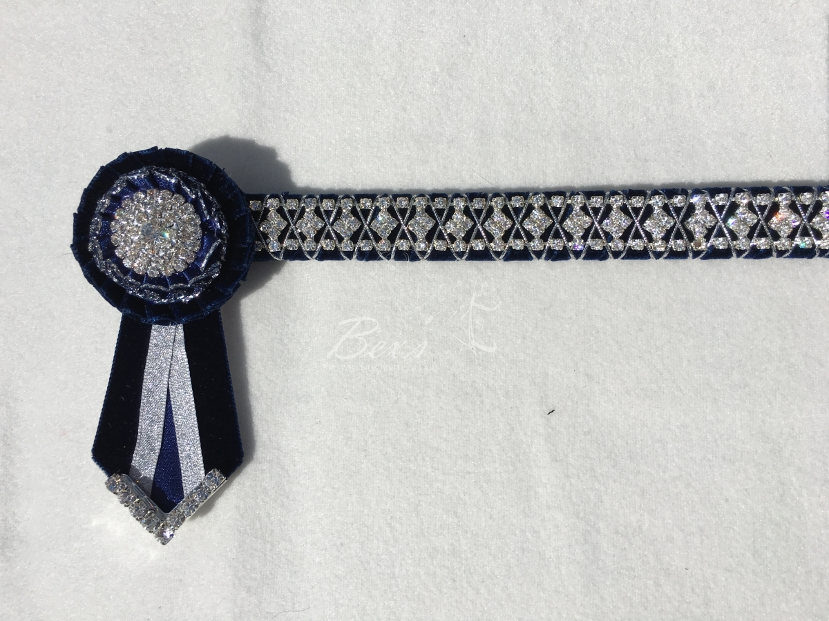 "3/4"" Crystal Show Browband: Navy velvet background, Silver diamond crystal chain woven on with Silver cord. Pleated rosettes with Silver centres. V shaped tails with Silver crystal flag tips"