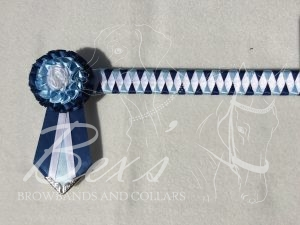 """3/4"""" Ribbon Show Browband: Navy, Light Blue and White satin narrow diamond. Pleated rosettes with fabric rose centre. V Shaped tails with Silver patterned flag tips"""