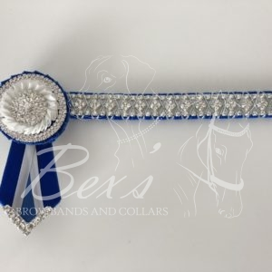 Royal Blue velvet and White satin with Silver diamond chain. Pleated rosettes with Silver crystal centres, rings and flag tips